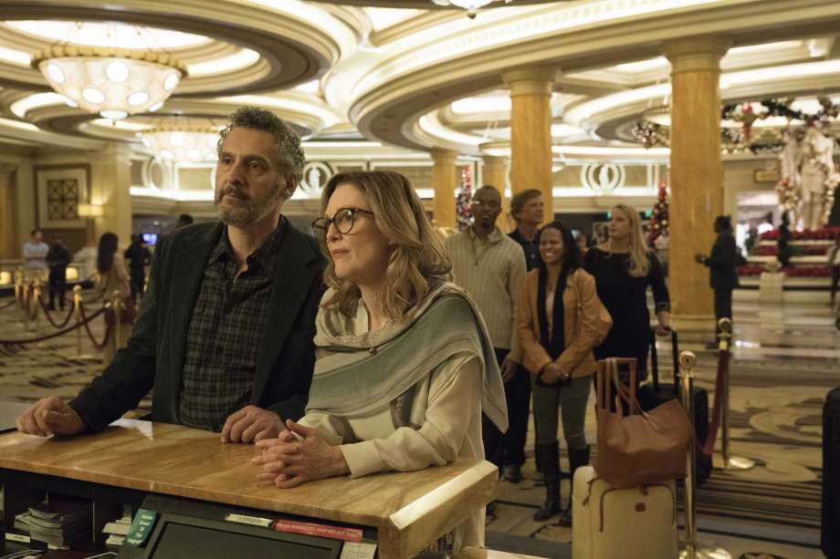 """John Turturo and Jullianne Moore star in """"Gloria Bell,"""" the story of a middle-aged woman traveling a path of self-discovery."""