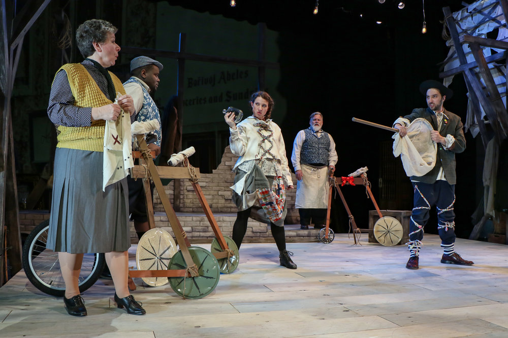 """Two lunatics (Nick Narcisi, right, Maggie Marks, center) get ready to apprehend and banish cycle owners (from left, Leslie Fitzwater, Donnie Williams and Joel Kopischke) in a scene from """"The Last Cyclist,"""" presented by the Cardinal Stritch University Performing Arts Department."""