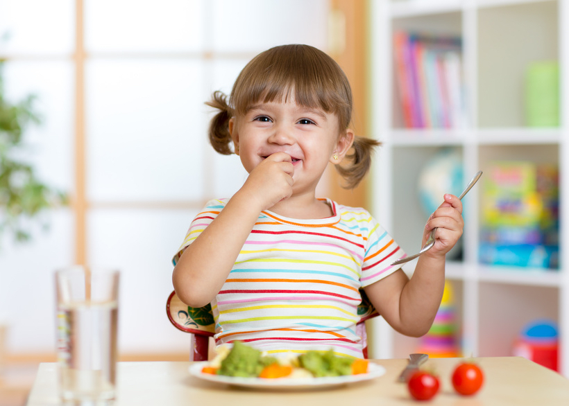 Happy child eating vegetables © Oksana Kuzmina.jpg