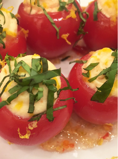 Vine ripened cherry tomatoes with sweet n' hot deviled egg filling on top of a Peggy's pepper jelly glaze @handcutfoods