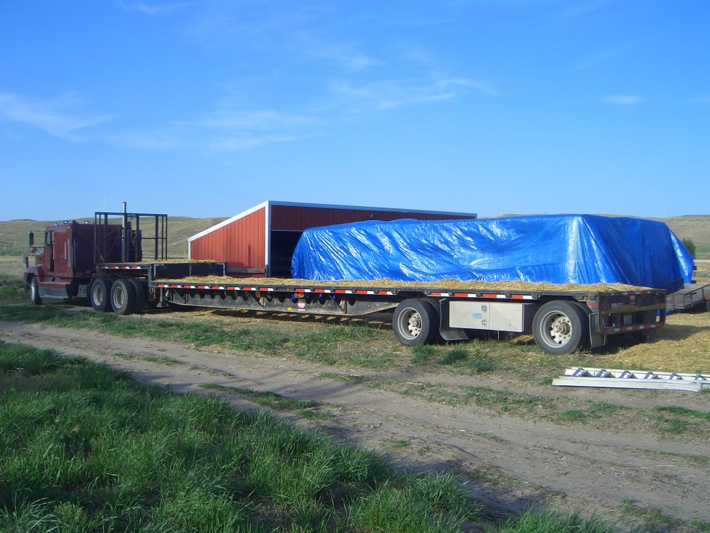 Bales unloaded and tarped