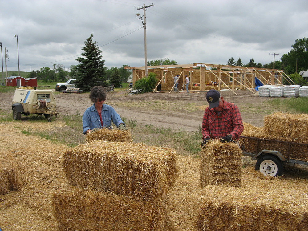 Barb & Buddy squaring off the bale ends so they fit together without gapping