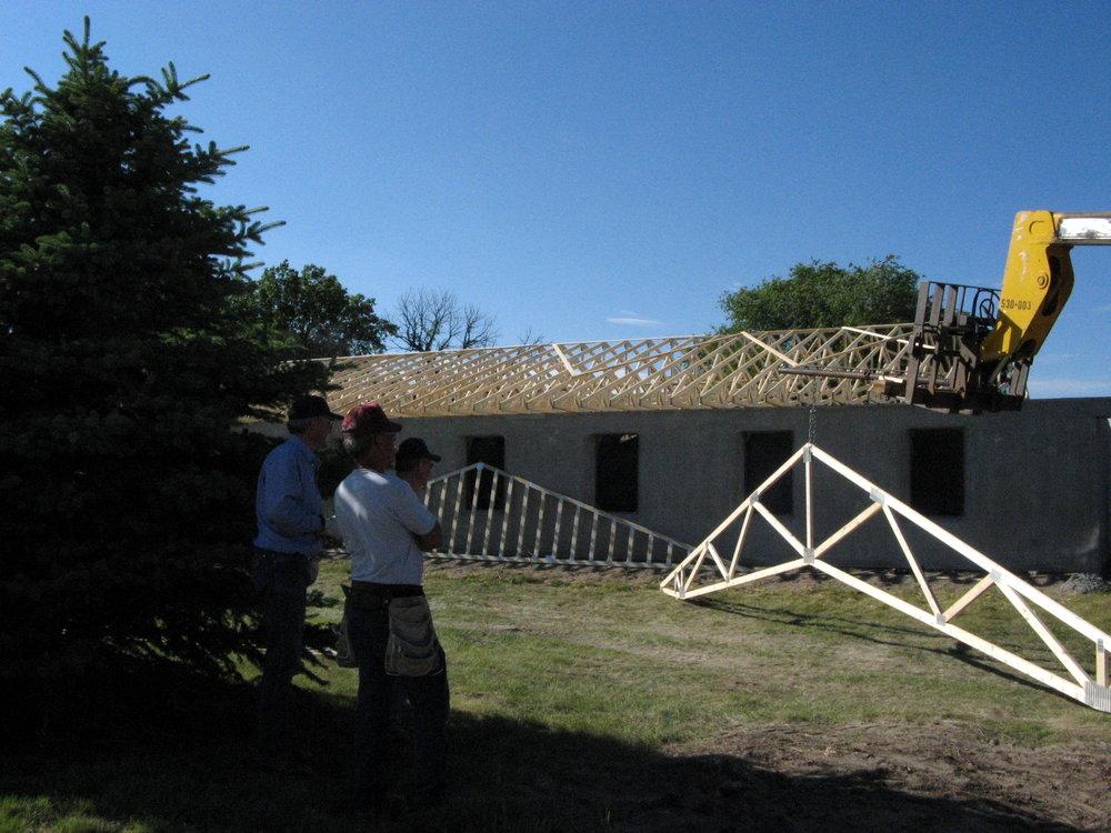 Installing scissor-trusses over the main work area