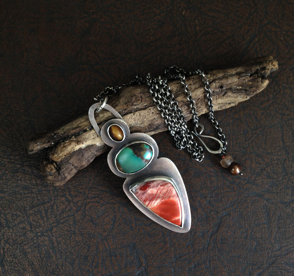 I love this necklace! The colors are so cool together. It is quite striking. I've been considering three or four necklaces from this shop, but couldn't narrow down my favorite. Luckily, the artist was having a sale so I was able to get two!  -Christine K