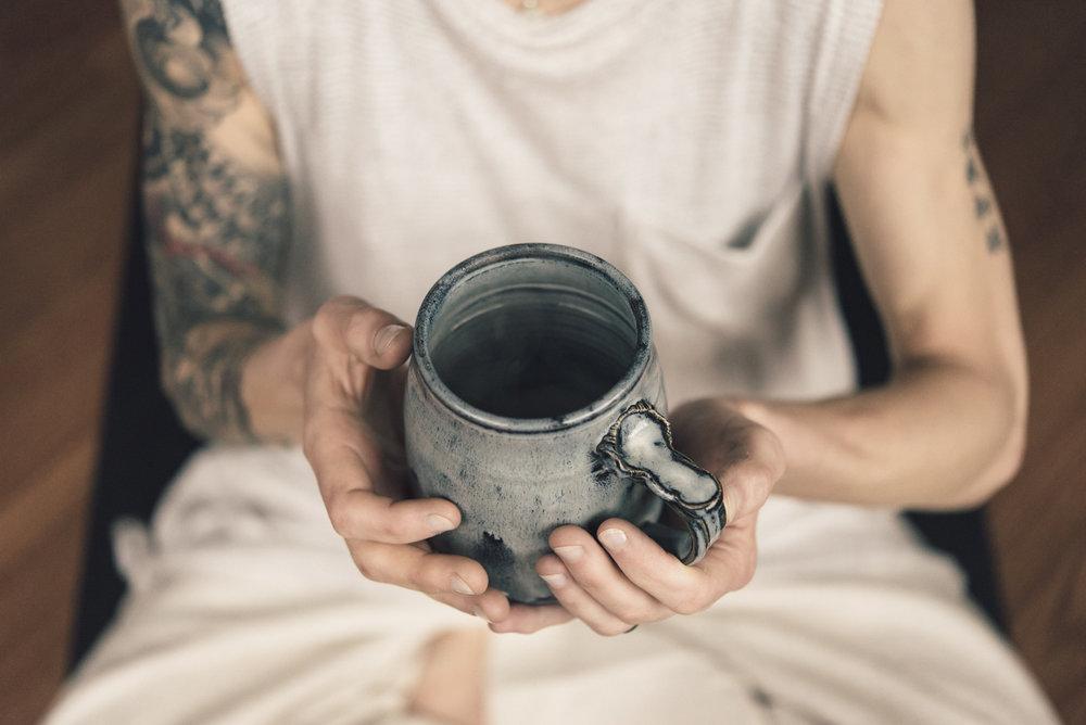 holding coffee mug tattoos