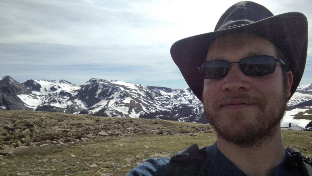 In the Rocky Mountains, my first time above the treeline. I'm also sporting my new hat :)