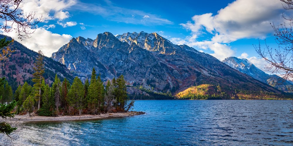 """""""Jenny Lake"""" - A view of the mountains across Jenny Lake from some paths near the visitor center."""