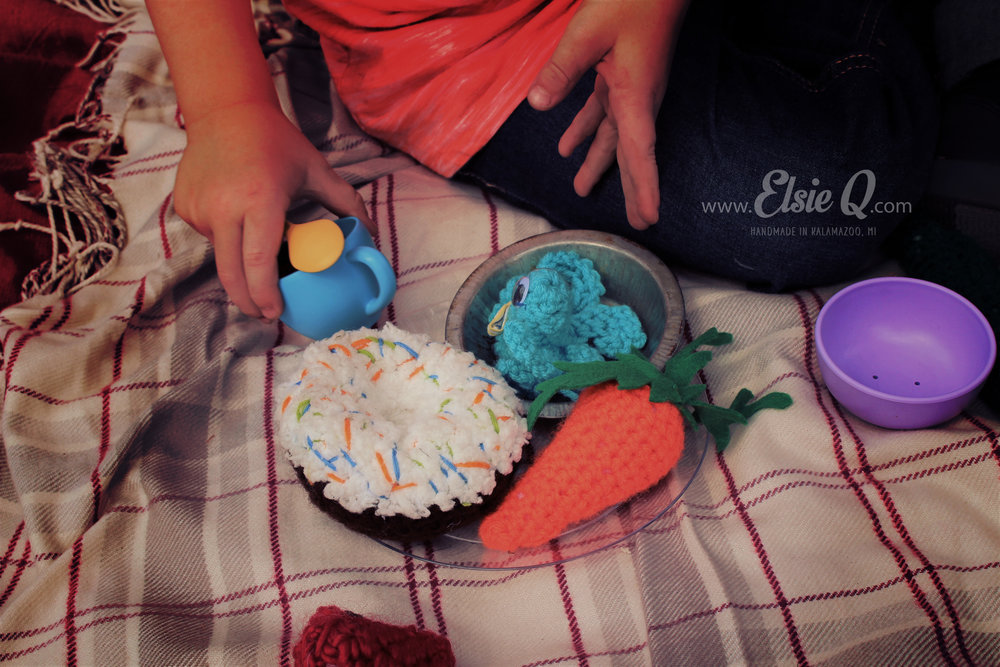Join the tea party and take home hand-crocheted fruits, vegetables, and baked goodies! I started making these soft, plush pieces for the children in my life, and now playtime is always a sweet treat.
