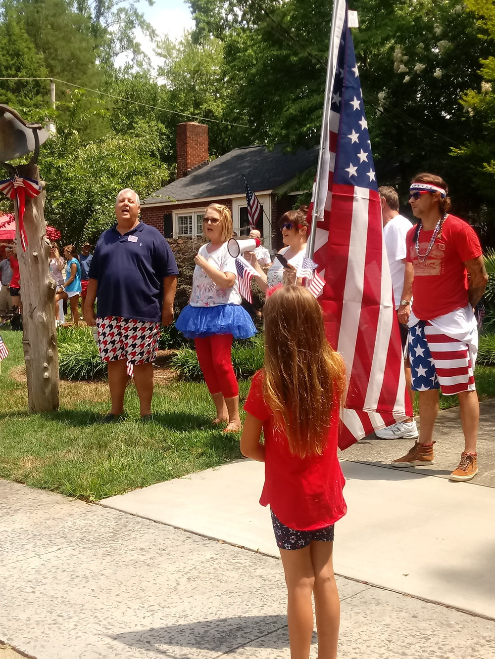 Stars & Stripes Forever - Original founders, the Johnson siblings sing with new neighbors, Brittany & Michael Kelly who will help keep the neighborhood tradition alive.