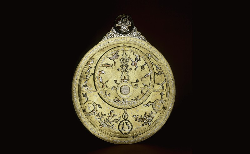 Astrolabe, made of brass inlaid with silver and copper.  Probably southeast Turkey northern Iraq or Syria AD 1240/1