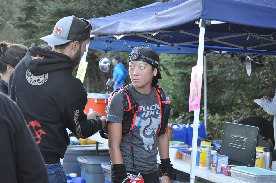 J giving me advice at mile 40 of the Superior 100. PC: Long Nguyen,  Fresh Tracks Media .