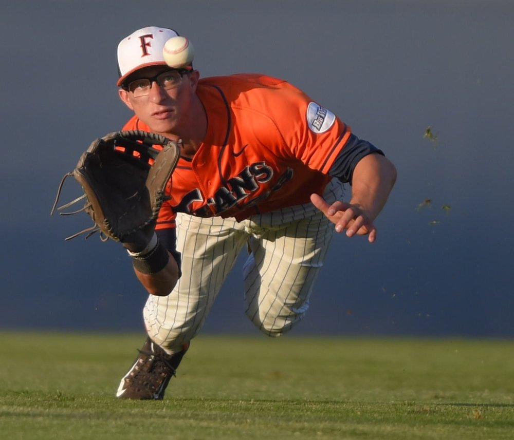 Former recruit Hunter Cullen makes a diving catch for Cal State Fullerton.