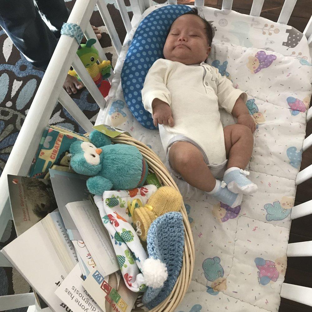 Photo of child receving Jack's basket (1).JPG