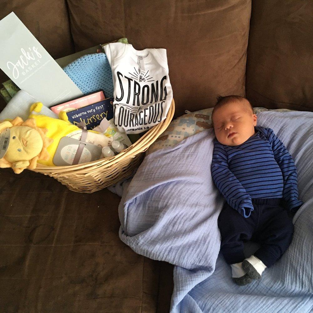 Photo of child receving Jack's basket (2).jpeg