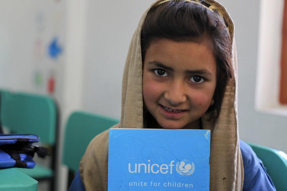 Bushra, 8, attends class at a UNICEF-constructed school in Gari Habibullah, Northwestern Pakistan. Credit: Asad Zaidi
