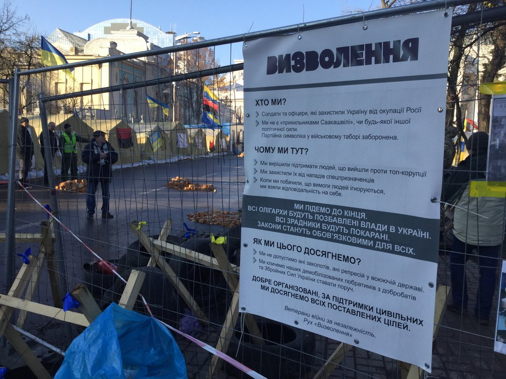 The entrance to the tent city, in the midst of the government quarter in Kyiv, where protesters have been camping out for weeks. The sign emphasizes that the occupants are not supporters of Mr. Saakashvili nor any other political entity.