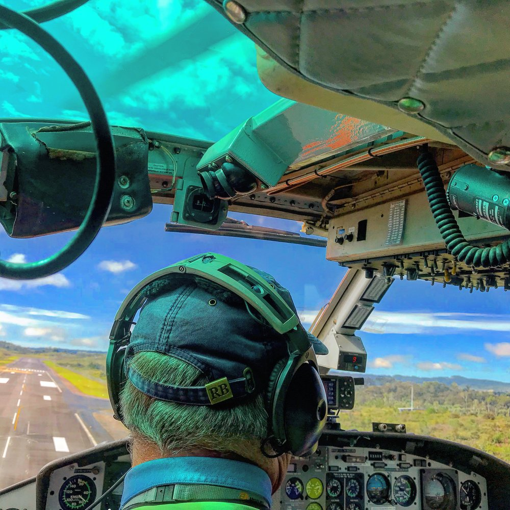 Landing by chopper on a remote airfield built by Exxon Mobil to support its enormous LNG operation in Hela Province.