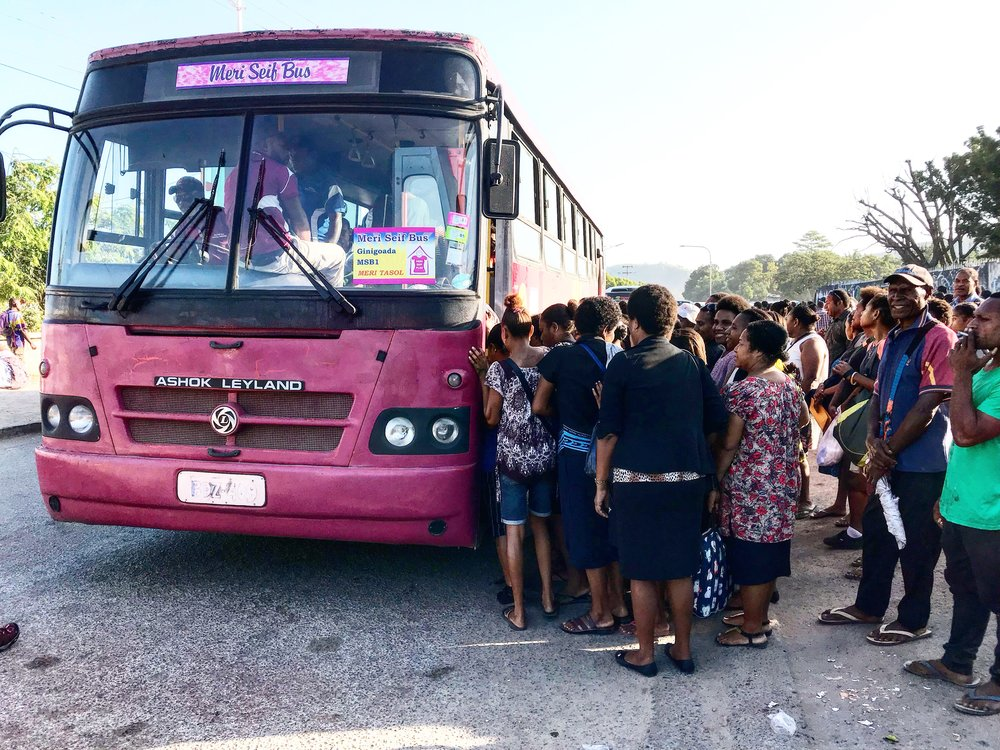 Women lining up to board the 'Meri Seif' bus on the outskirts on Port Moresby