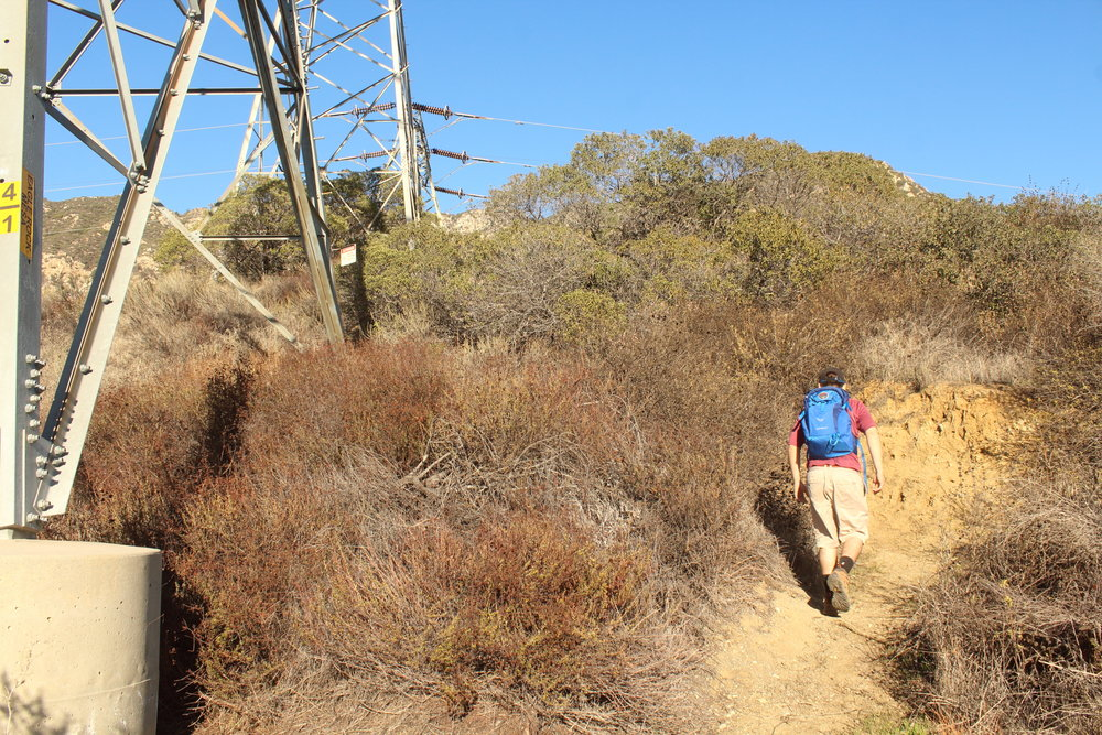 Hiking past electrical tower