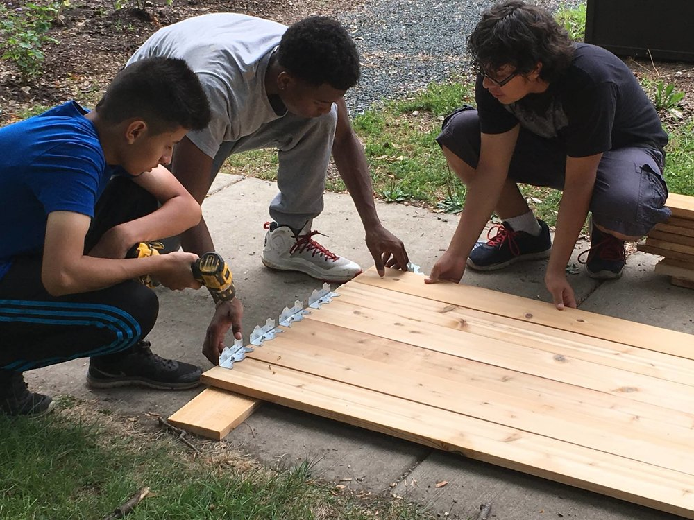 DBGE youth building accessible planter boxes for gardeners who cannot kneel