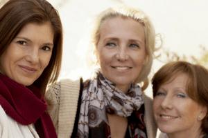 3 Happy Women in a Women's Gathering