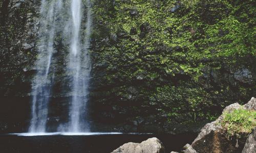 Living Water waterfall in mountain pool