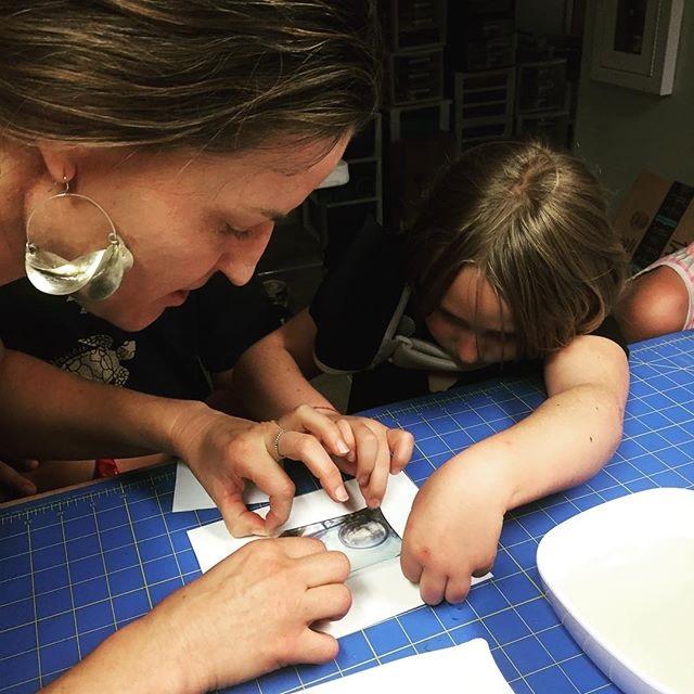 Oceanna helping a student do her first Polaroid transfer!