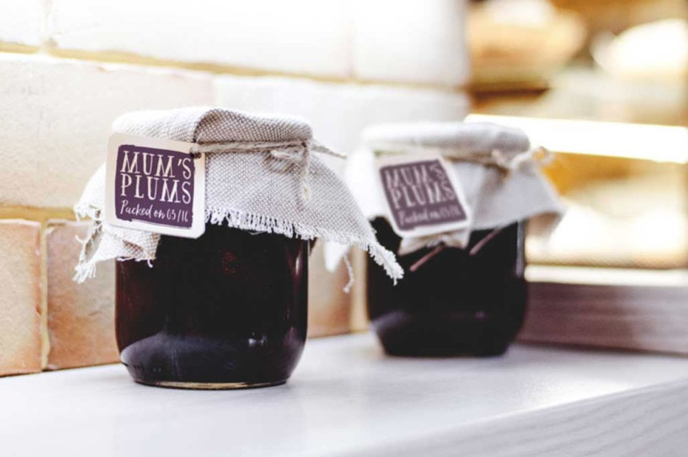 Jam jars with plum jam