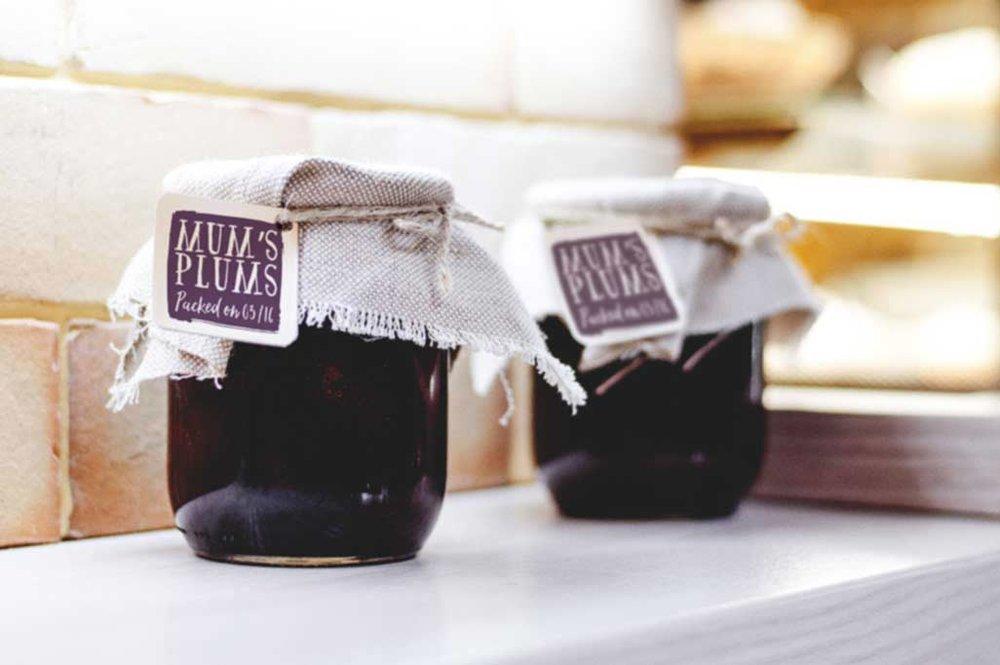 Jam jars with plum jam