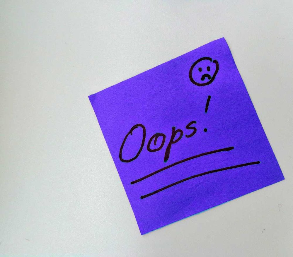 Purple post-it note with 'oops' written on