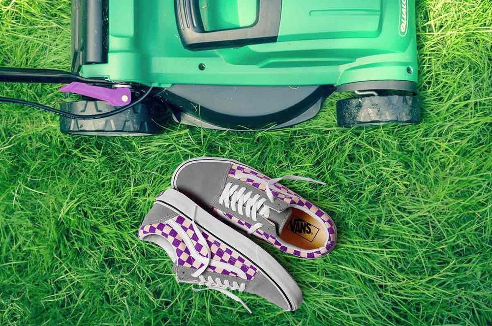 Children's vans next to lawn mower and grass