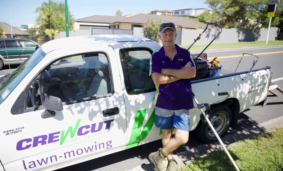 Smiling Crewcut operator in front of his ute