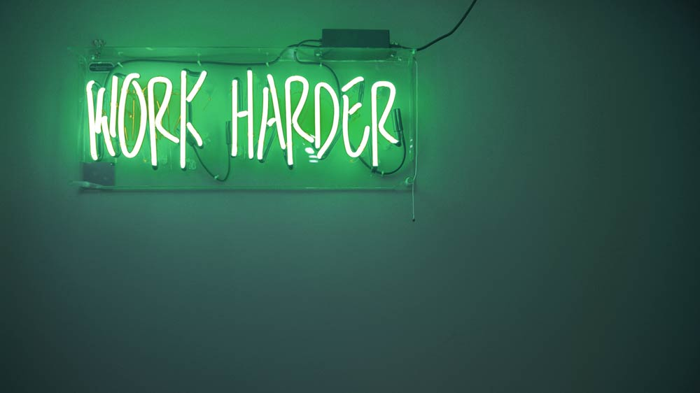 Green work harder neon sign