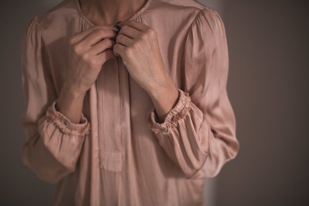 Stylish detail of a blush coloured blouse