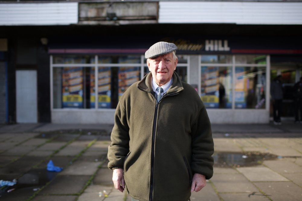 John is 82 and has been married for 58 years. He's from Cork, Ireland. I asked him if he'd just been in the betting shop and he said 'no, no, no, I don't bet. My father owned a butcher's shop and I took £20 from the till to bet on the dogs. It was 1952, that was a lot of money in those days. The dog fell and came in last and I lost the lot and I had a lot of explaining to do. I've never bet since that day.' He'd been in the betting shop to find a lady he knew called Josie, who is 88 and was married to John's friend 'The Cowboy'. She likes the cards. She'd recently fallen and hurt her leg & hip. John said sadly 'If I don't find her I don't know what I'll do with the rest of my day'.
