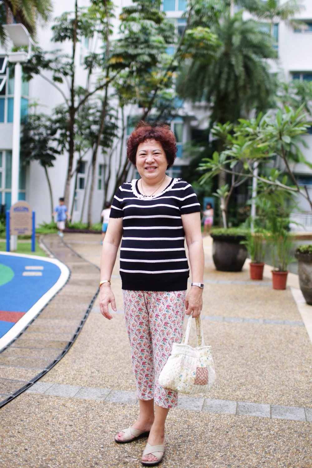 This lady lives in the apartment block and all the kids love her. They all call her Grandma as a respectful form of address.She couldn't speak English and I couldn't speak Malay so we communicated in sign language.All the kids in the apartments love this lady.They all call her Grandma as a respectful form of address. This lady lives in the apartment block where I'm staying with my friend and her children.