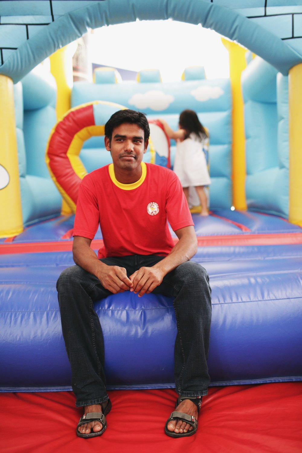 Kumar's from India and has been in Singapore for three years. He loves his job, especially when he gets to do kids' birthday parties with the bouncy castles.