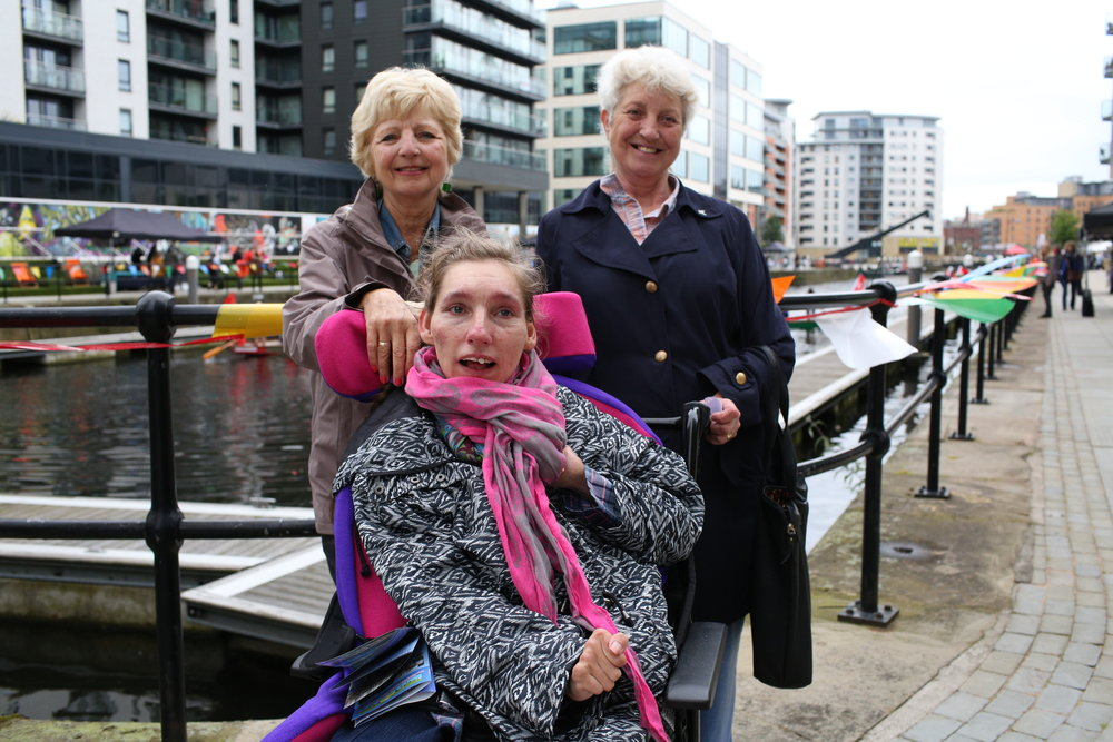 Dawn, Dot & Pam are on holiday from Sheffield. Dot & Pam are sisters and they're Dawn's aunties. Dot had just bought Dawn a really pretty pair of earrings like little bicycles so they were all smiling as I walked by. They told me that once a month they take Dawn on a trip away. This trip they were visiting the Leeds Waterfront Festival because they came last year and loved it.They said that they're most looking forward to the dragon boat racing and the carnival, which is full of great food and music. A real party atmosphere!