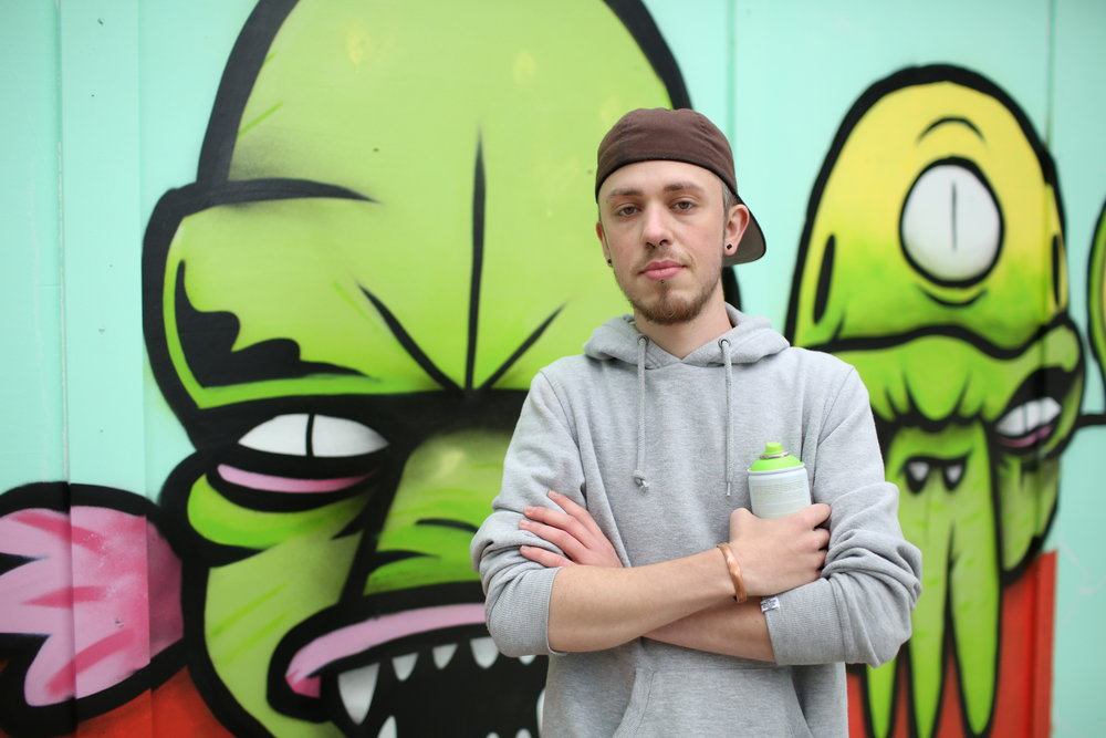 Jay is one of the artists commissioned to create graffiti along the waterfront as part of the festival. His drawing will become three strange and wonderful creatures of the deep and will be finished over the next two days. The best thing about the festival for him is that it brings all sorts of people together to have fun, and having opportunity to create colourful artworks for everyone to see. Jay also runs workshops with young people in Leeds.@jaypeeart89