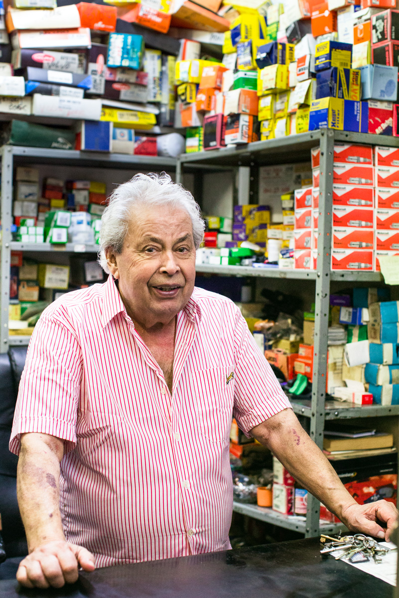 """This is Andreas, he's from a beautiful place in Cyprus where he owns a lot of land and grows pomegranates. He has 40 trees and when they fruit he shares his pomegranates with local people. He's owned his garage in Gospel Oak for 44 years. He did once think of going back to Cyprus but when his wife died, he decided to stay, he said he's too much of a Londoner now. Grace who works with him added mischievously 'Andreas has too many women to leave'.His best ever customer was Lynsey de Paul, he said sadly, """"she was in all the time and always bought chocolate. Then she stopped coming. Five weeks later I found out that she'd died. I miss her."""""""