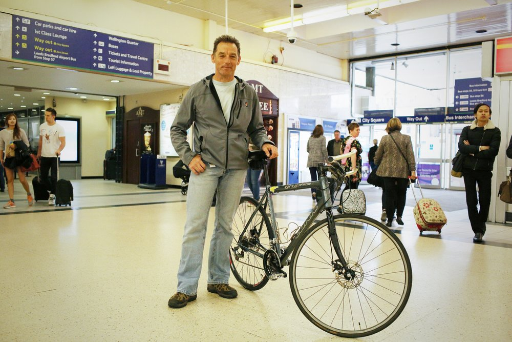 I saw Robert at Leeds Station and asked if I could take a portrait of him and his bike because in a few days time Leeds is hosting Le Grand Depart for the Tour de France and I liked the bike link. Robert had the most amazing story. 3 years ago he had a terrible accident which left him in a coma and fighting for life. He used to be a champion cyclist and rode all over the world and his surgeons said he'd never be able to do that again. But, he was determined! Despite all odds he's back on his bike and living each day like it's his last. I asked what was on his list of things to achieve. He told me 'well, I've never been married!!!' He's also planning to cycle all the way around Australia next year. He's the first person I've met today in Leeds and I'm so pleased to have met him. What an inspiration!