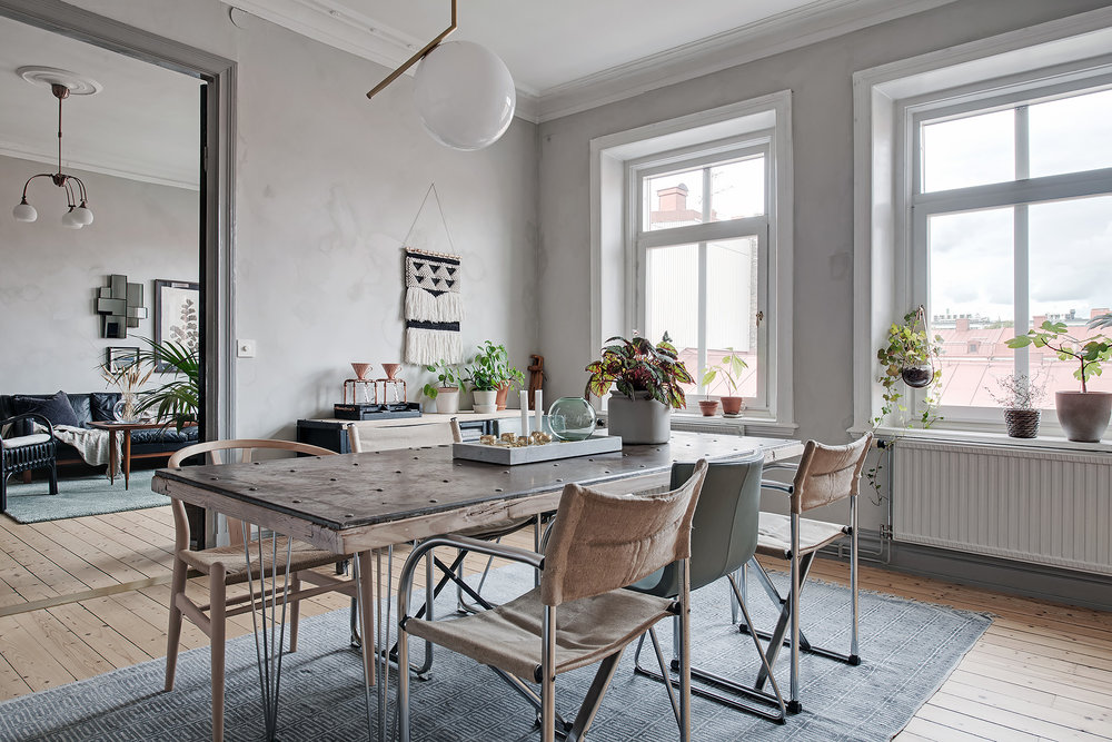 Grey dining room with textured rough walls