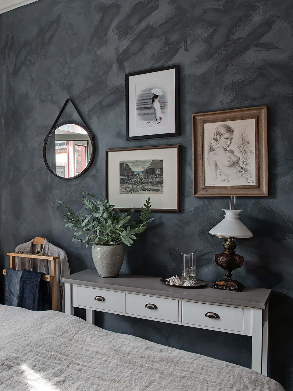 Grey bedroom with gallery wall