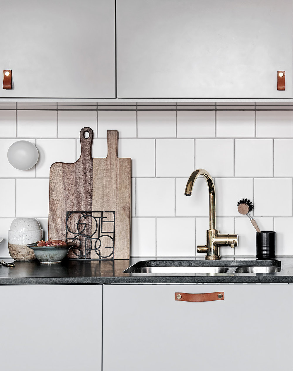 Grey kitchen with subway tiles