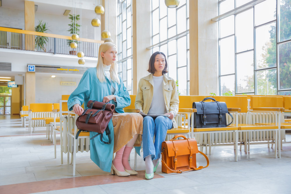 Fashion shot of models with luxury leather bags