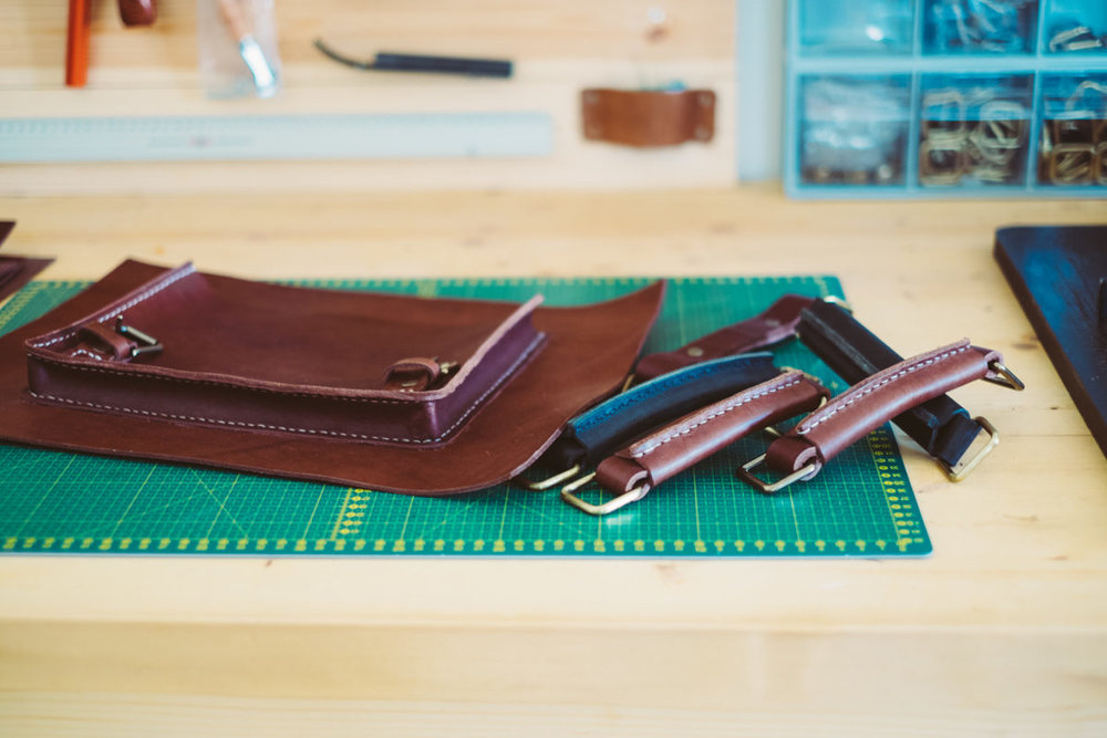 Saddle stitched full grain leather bag in workshop