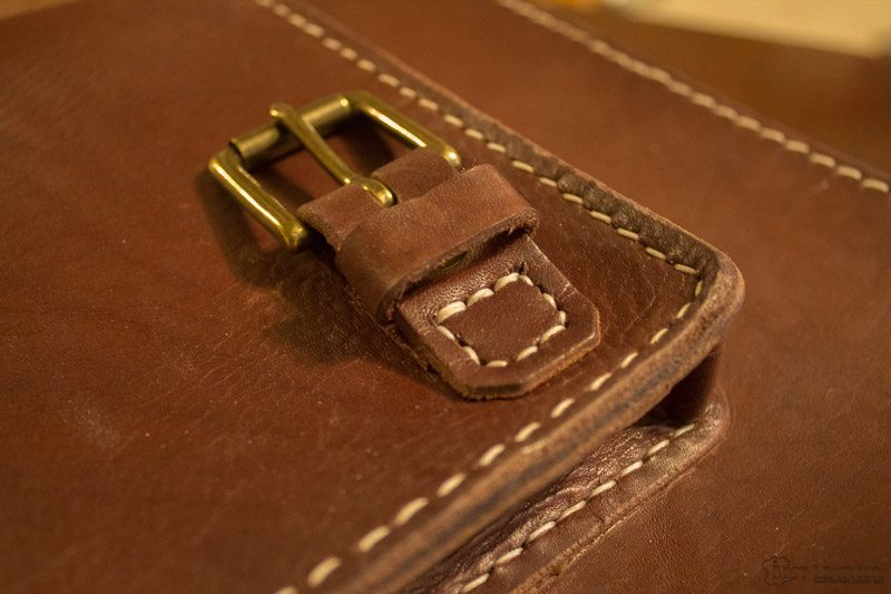 Saddle stitching and solid brass hardware on BennyBee bag