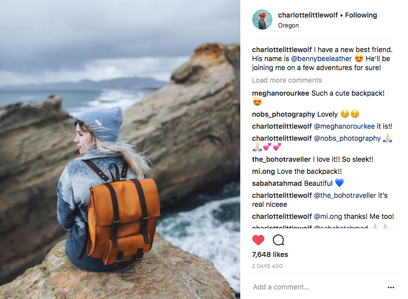 Instagram creator in nature with handmade leather backpack