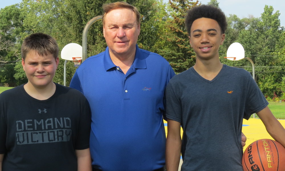 Scott with his grandsons Ryan (on the left) and Kobe (on the right).