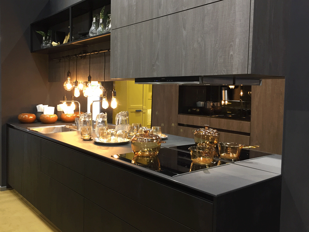 Matte black ash and rail handles make for a sophisticated kitchen.